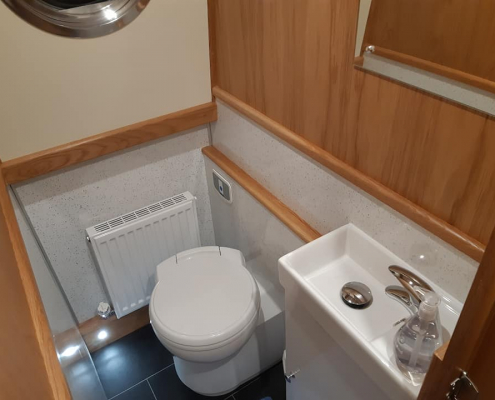 a modern looking toilet on board a narrowboat